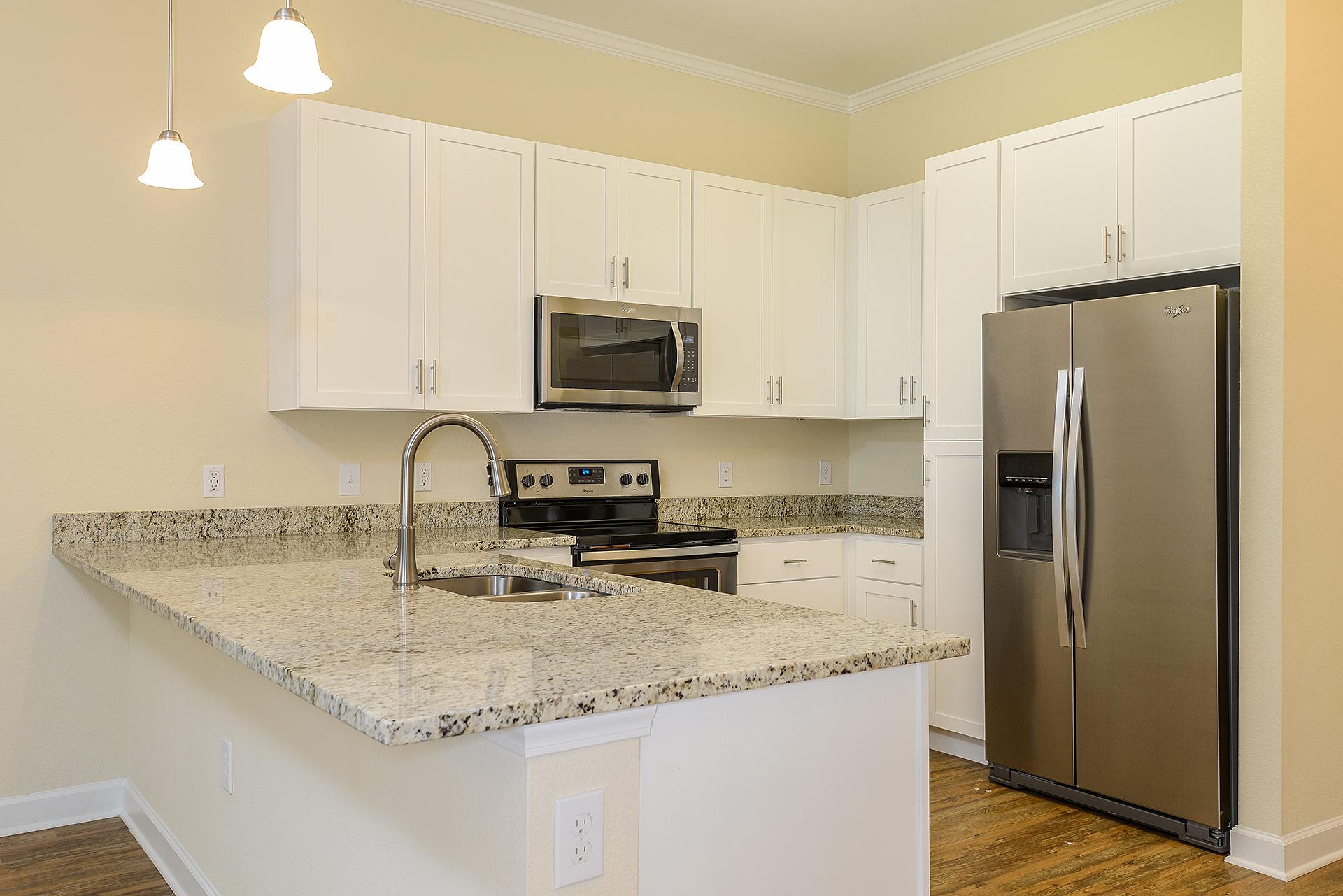 Wooden floor empty unit with kitchen