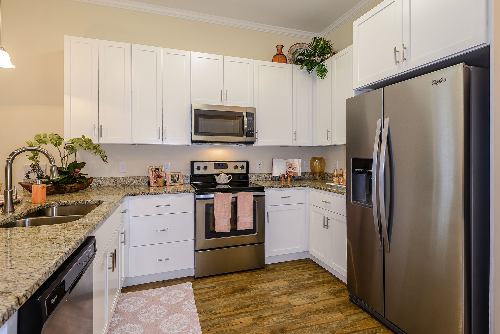 Example kitchen area with pink decor and wooden floors