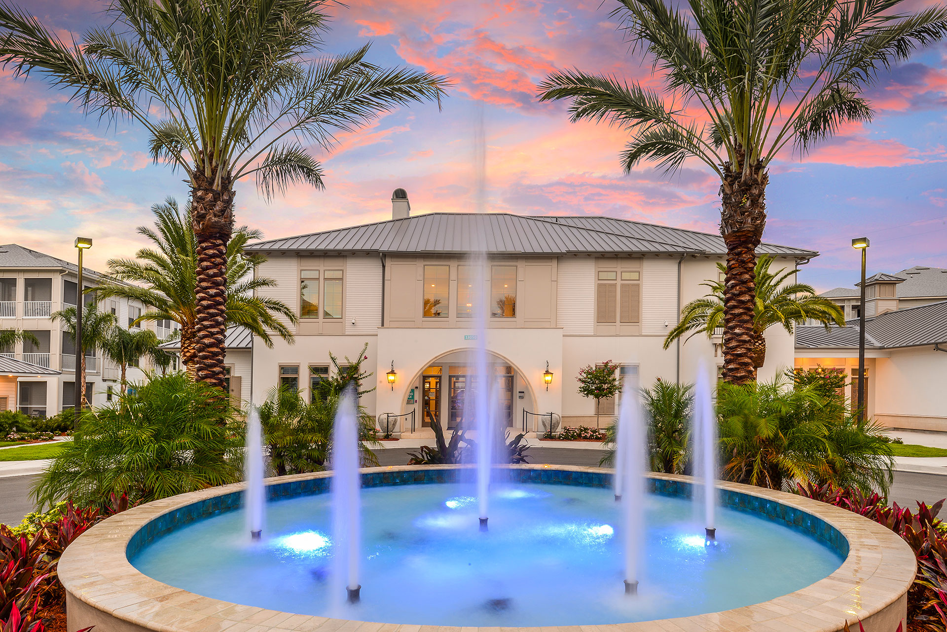 Multi level luxury apartment with fountain and palm trees