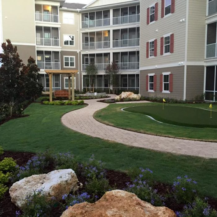 Monterey Pointe Market Rate Senior Living Apartments walking path in rear of building