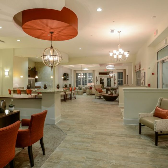 Monterey Pointe Market Rate Senior Living Apartments community area with tables