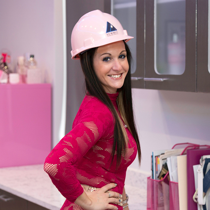 Woman in a Summit hard hat smiling
