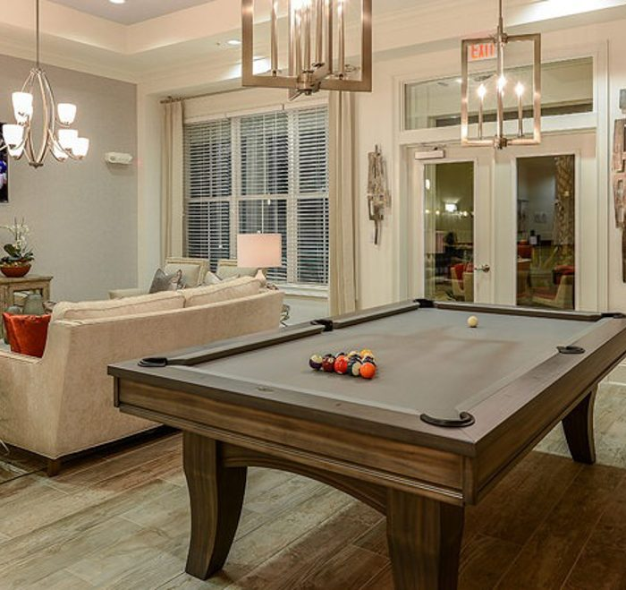 Monterey Pointe Market Rate Senior Living Apartments billiard table and sitting area