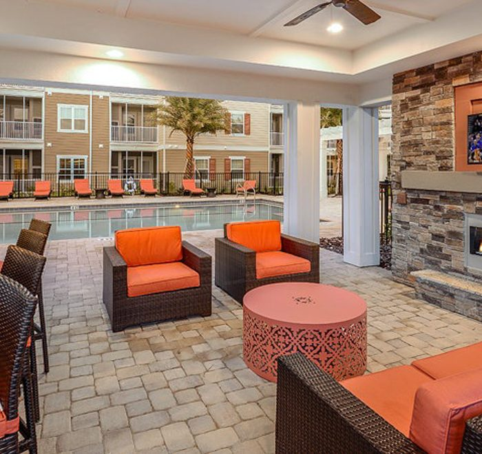 Monterey Pointe Market Rate Senior Living Apartments lounge area by pool