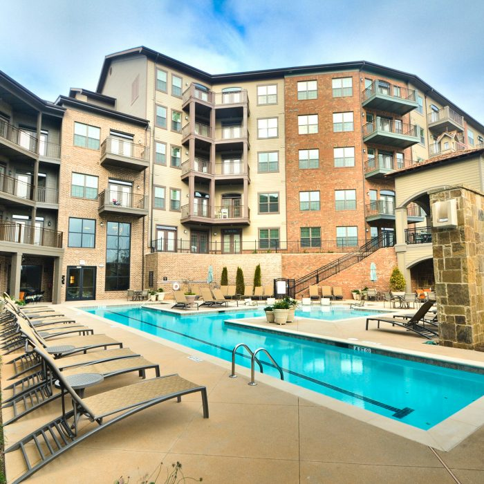 Multi story apartment complex with pool