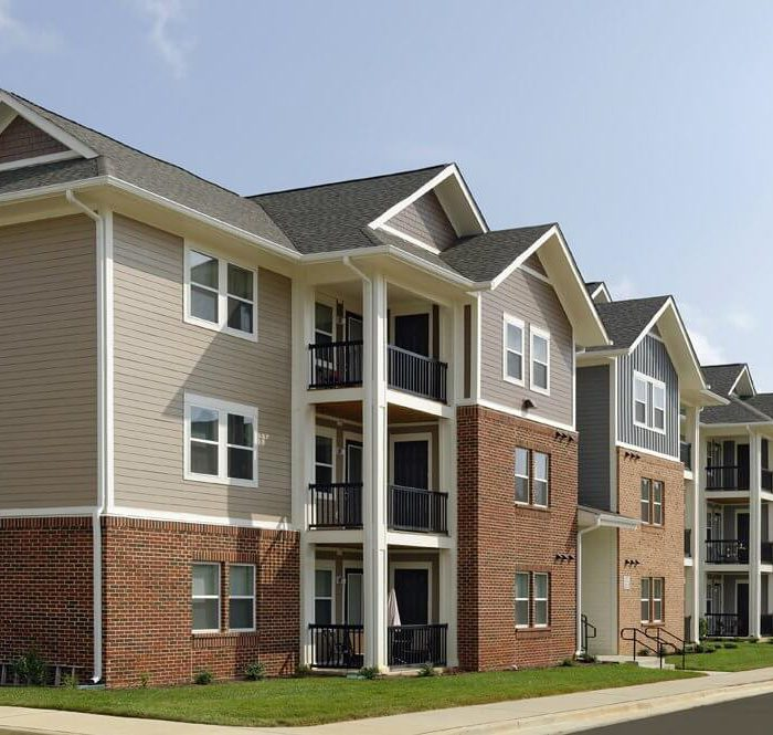 Brown multi story apartment complex