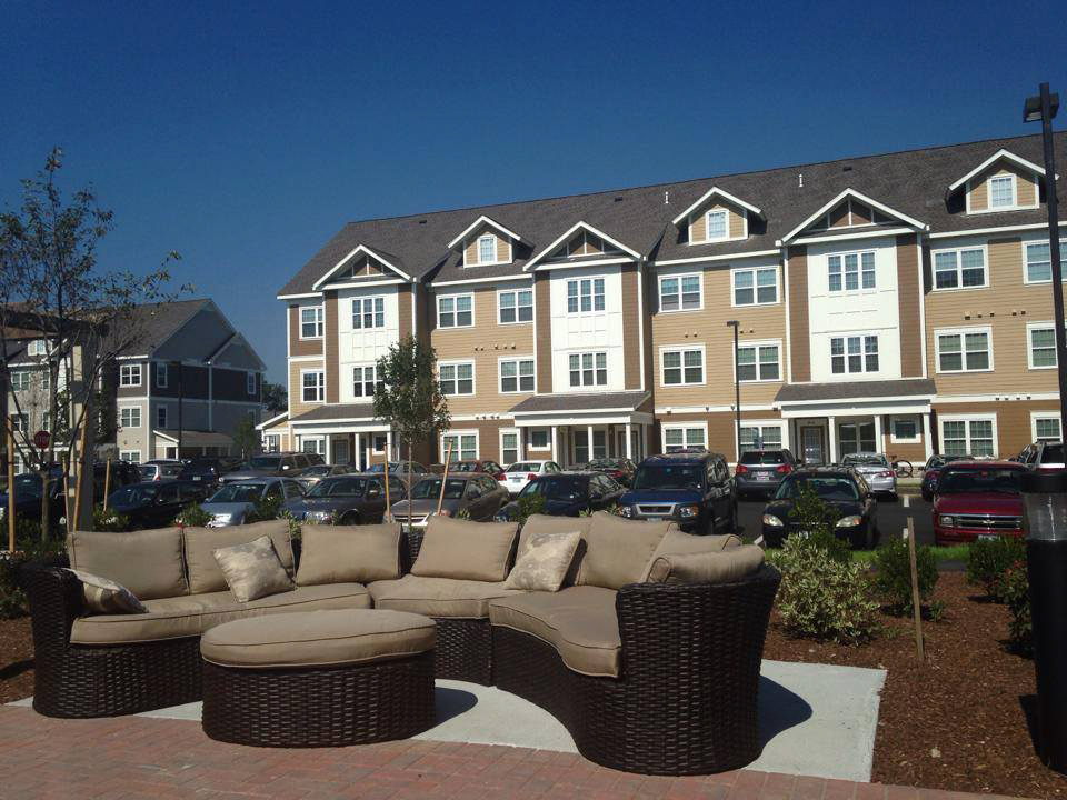 Multi story student housing with outdoor couch area