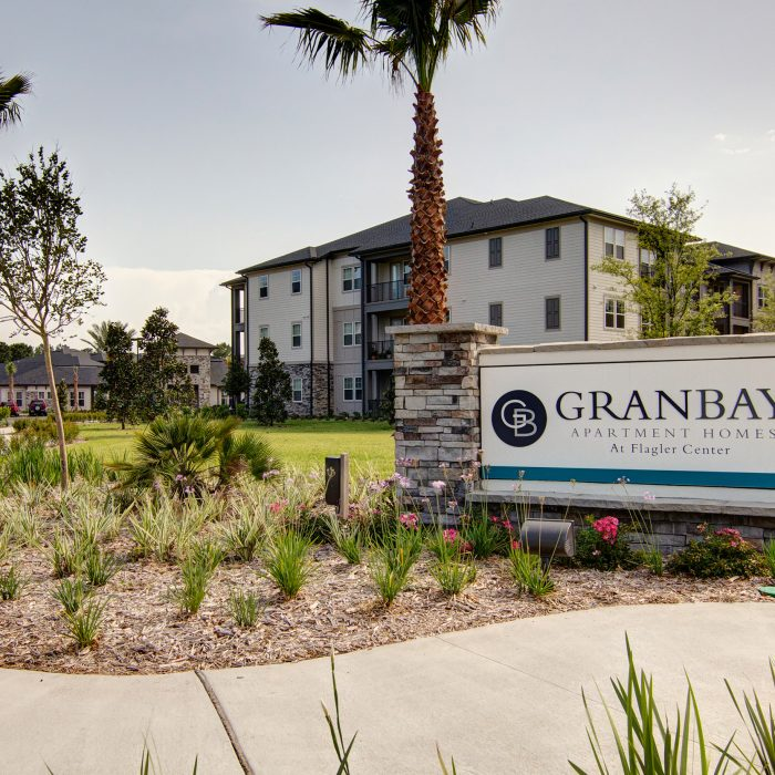 Multi story apartment complex with Gran Bay sign