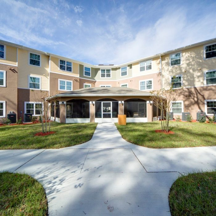 Multi story senior living facility courtyard entrance
