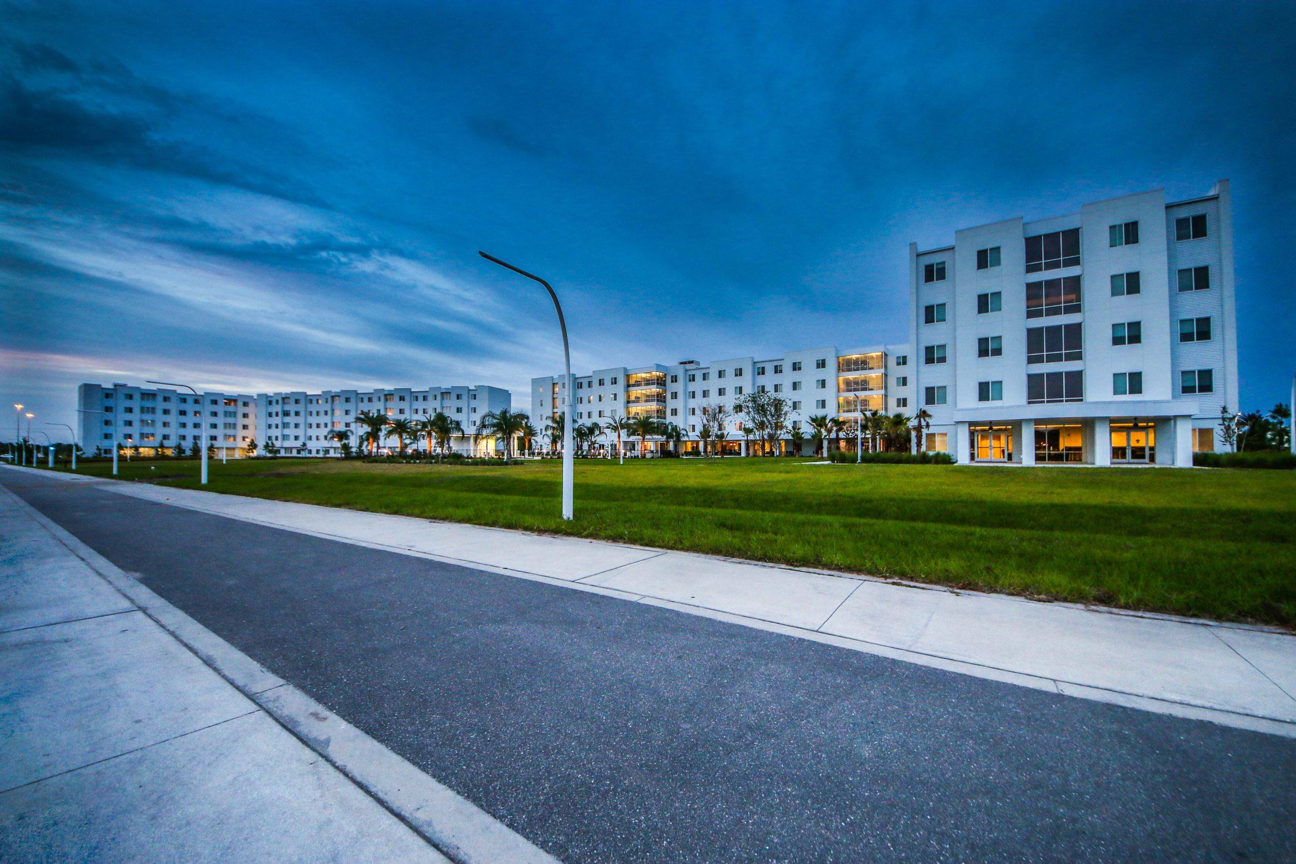 Multi story student housing development in evening