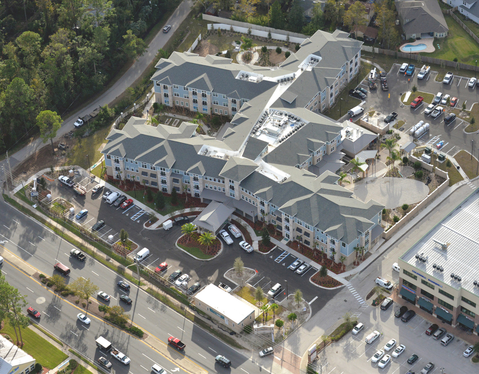 Senior living facility aerial view of complex and parking lot