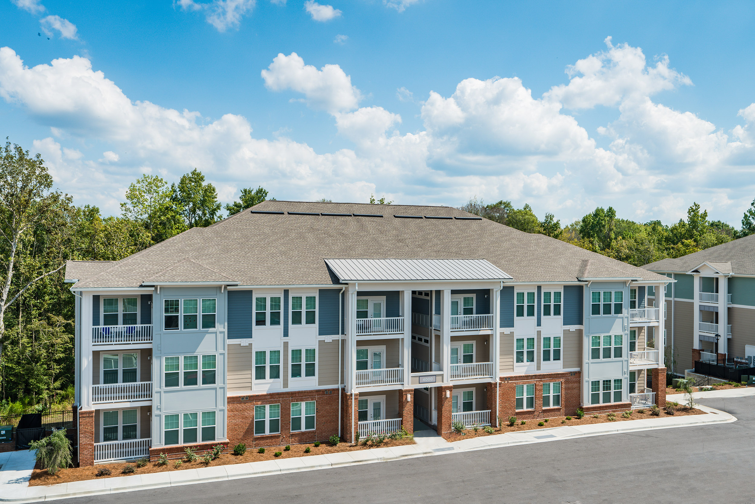Teal and brown multi story apartment complex