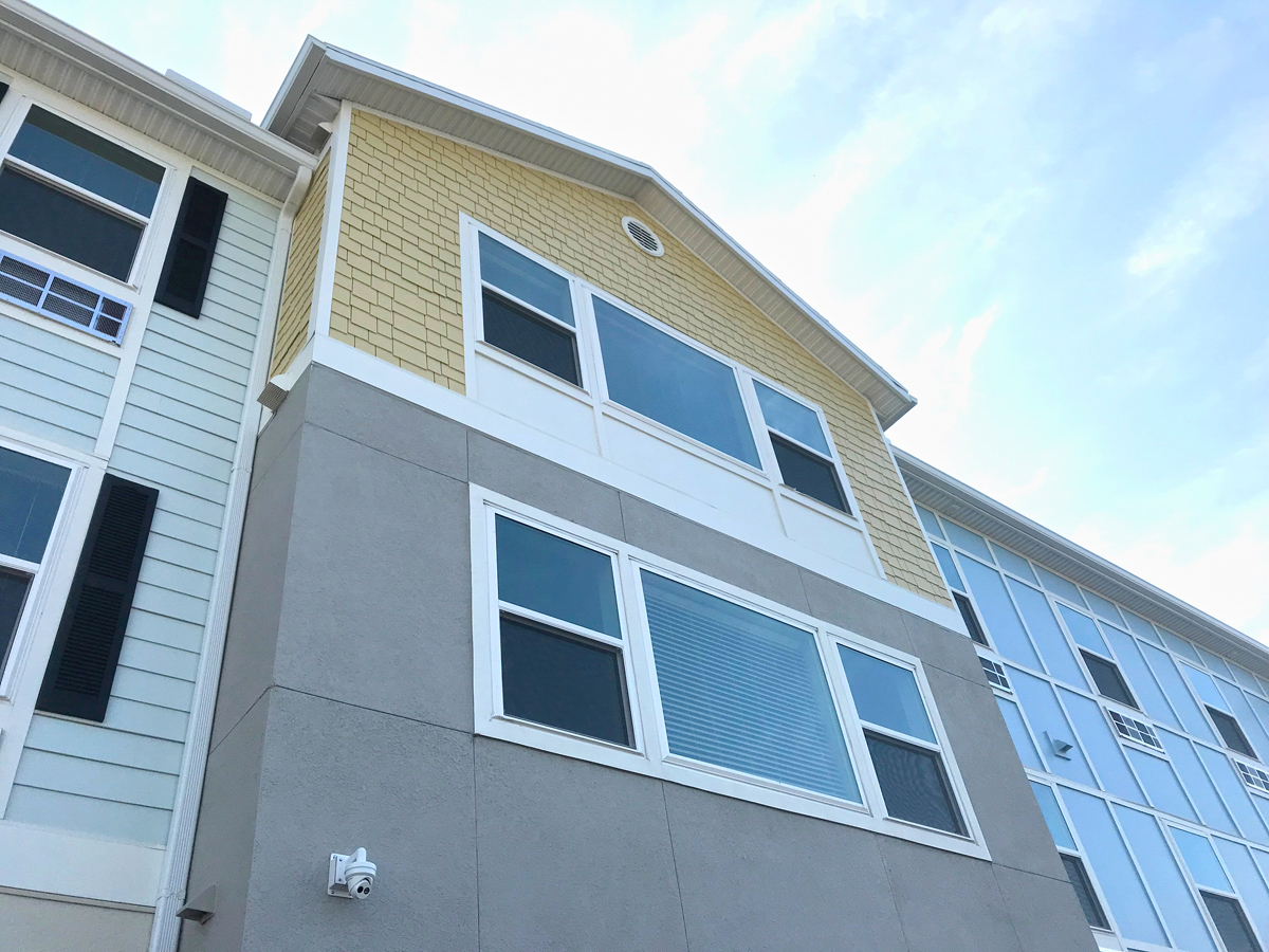 Multi story mixed use apartments upward view