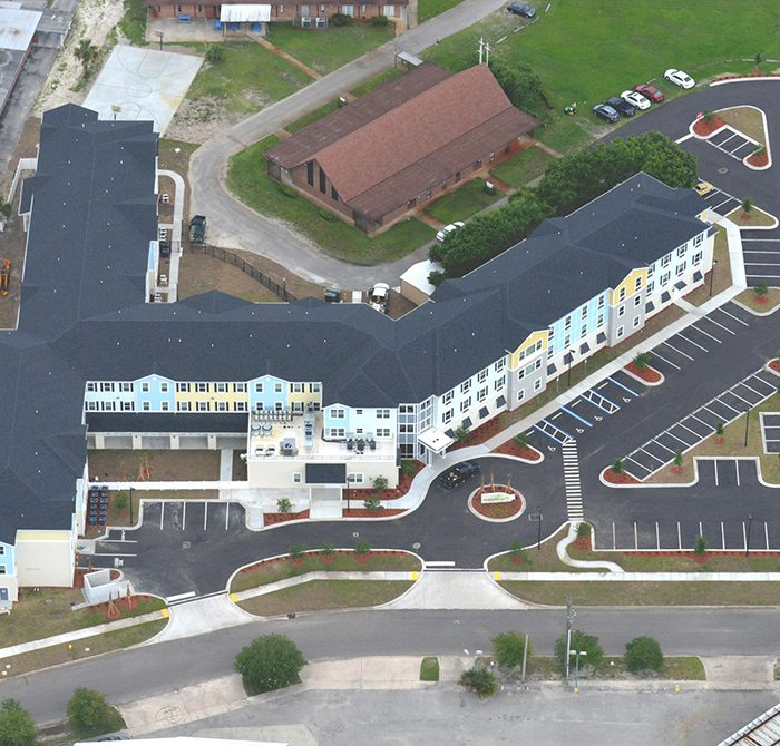 Multi story mixed use apartments by church aerial view