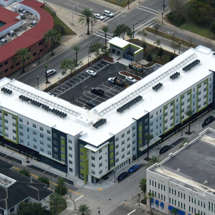 Multi story green and white apartments aerial view