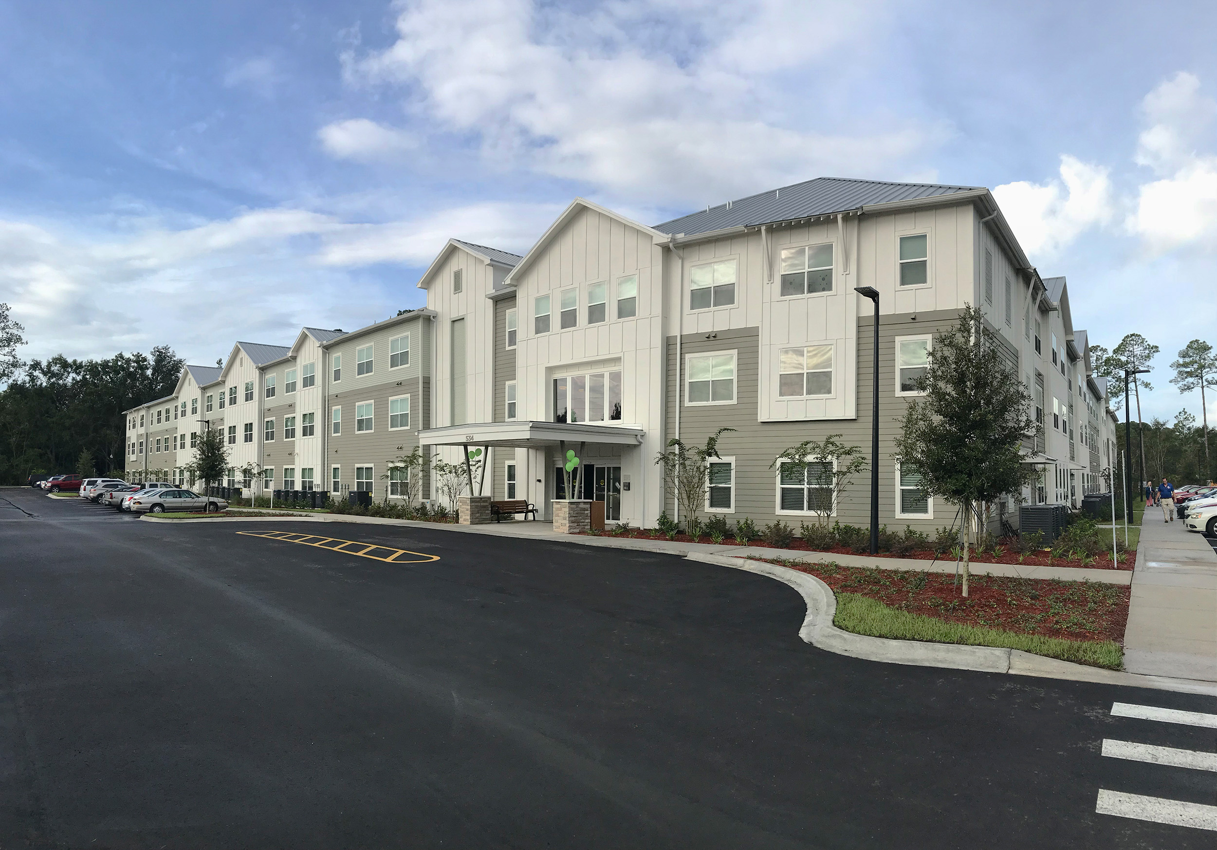 Multi story senior living apartments front entrance