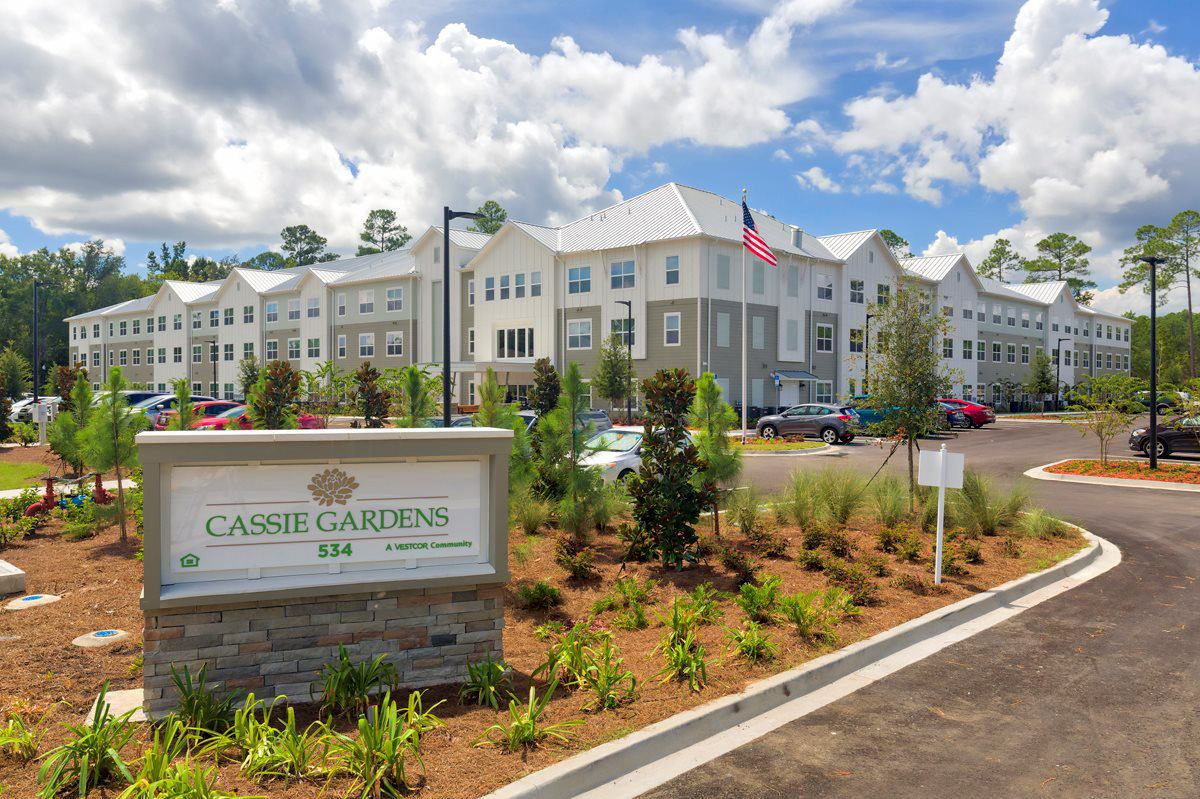 Multi story senior living apartments with Cassie Gardens sign