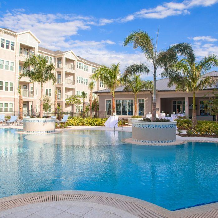 Multi story apartment building luxury pool area