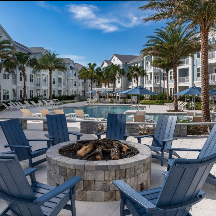 Luxury multi story apartment complex view with fire pit