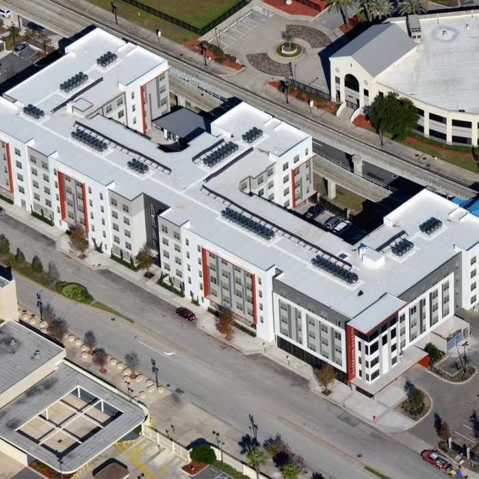 Red white and gray multi story apartment building aerial view