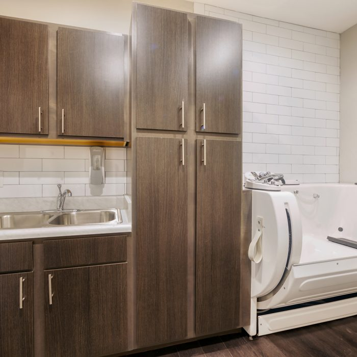 Personal room for seniors with wood cabinets and a handicap accessible bath