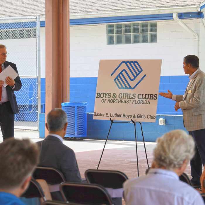 Man speaking to crowd for Boys & Girls Club Project by Summit Contracting Group