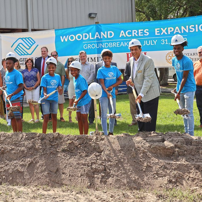 Kids posing with shovels for groundbreaking event at Boys & Girls Club Project by Summit Contracting Group