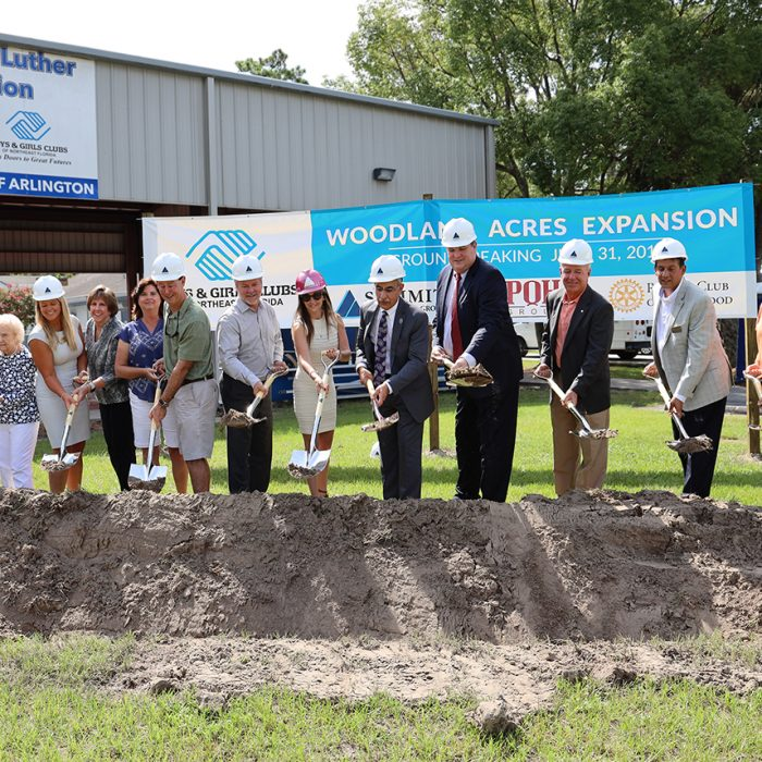 Contractors and executives digging into ground for new building development