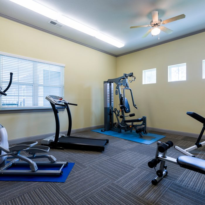 Fitness room with equipment at K9s For Warriors Project by Summit Contracting Group