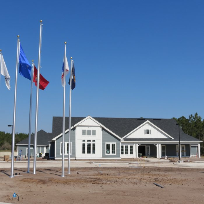 K9s For Warriors Project by Summit Contracting Group building with flagpoles