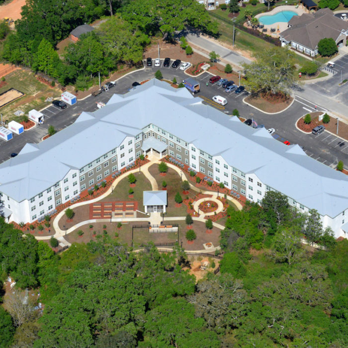 aerial view of 3 story apartments building