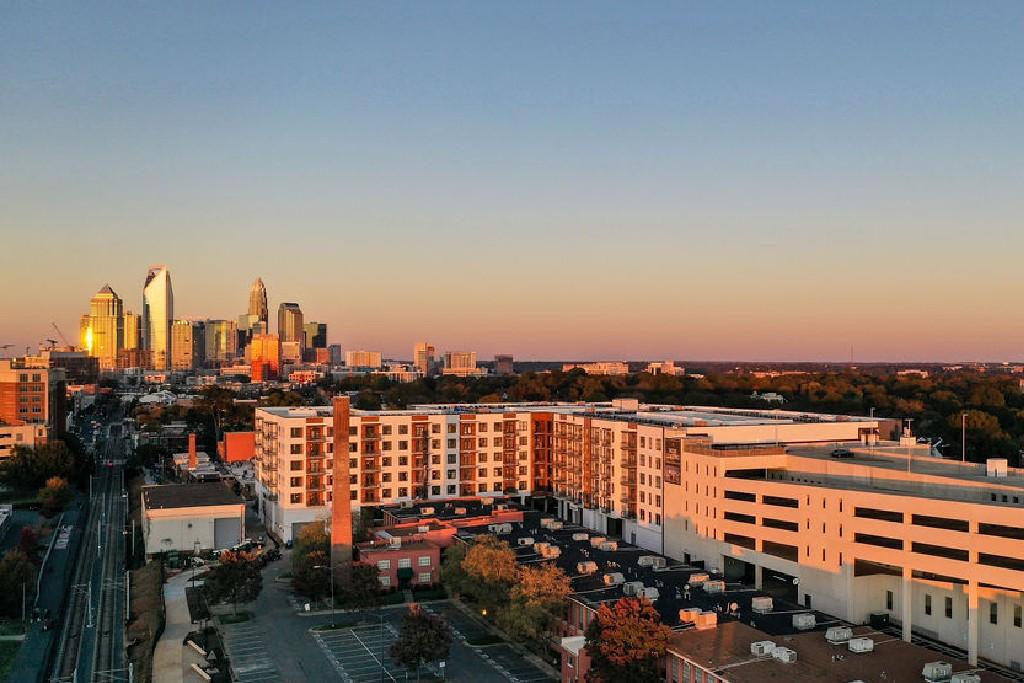 aerial skyline of Charlotte NC and Novel Atherton