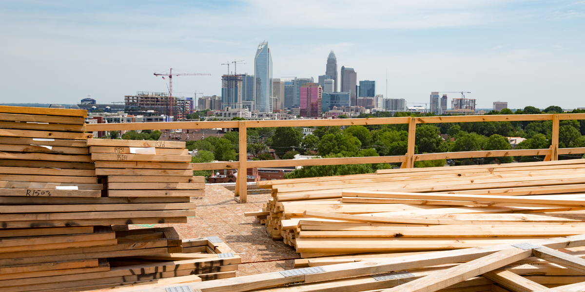 view of Charlotte skyline with lumber in foreground