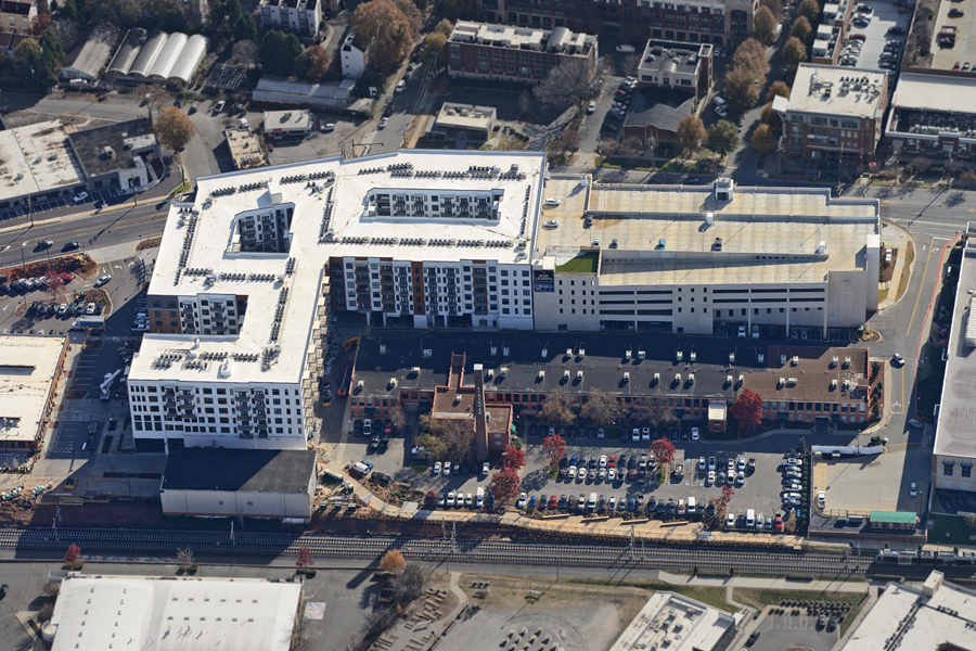 aerial view of Novel Atherton Mill stack, large building and parking garage