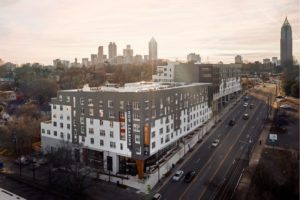 Novel O4W apartment building with Atlanta skyline