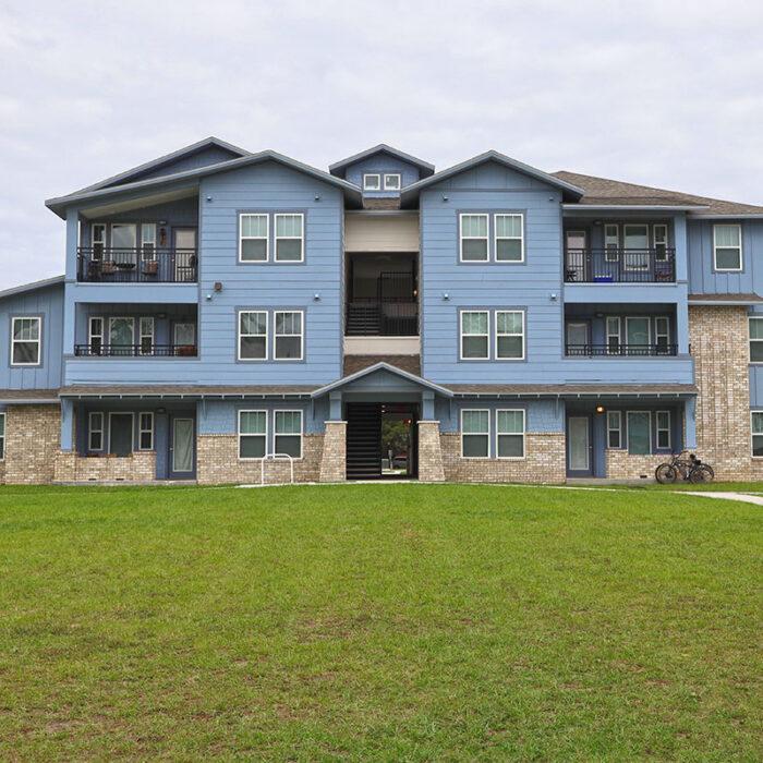 Woodland Park blue 3 story apartment building