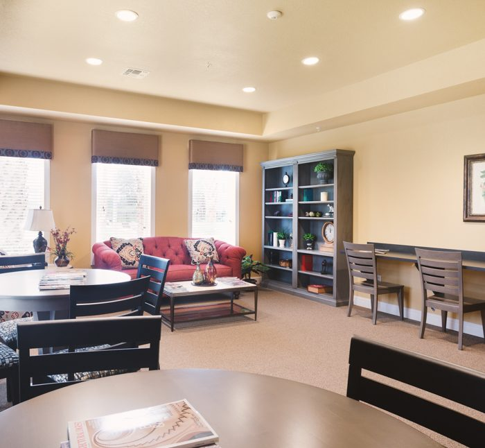 Madison Crossing Market Rate Senior Living Apartments lounge area with a couch