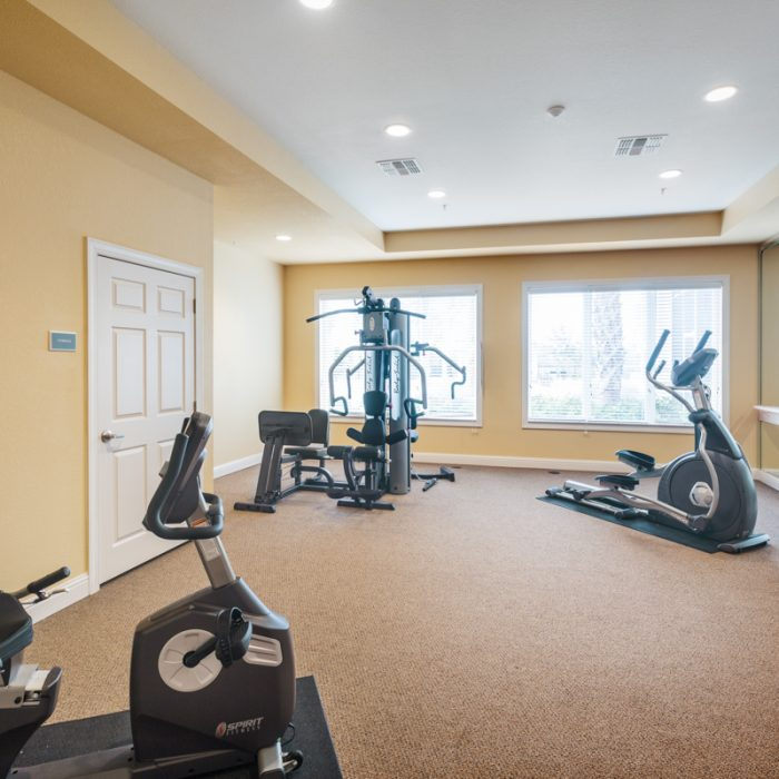 Fitness Area with equipment for Madison Crossing Market Rate Senior Living Apartments by Summit Contracting Group