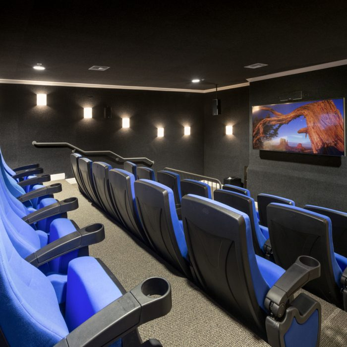Luxury theater room for Madison Crossing Market Rate Senior Living Apartments by Summit Contracting Group