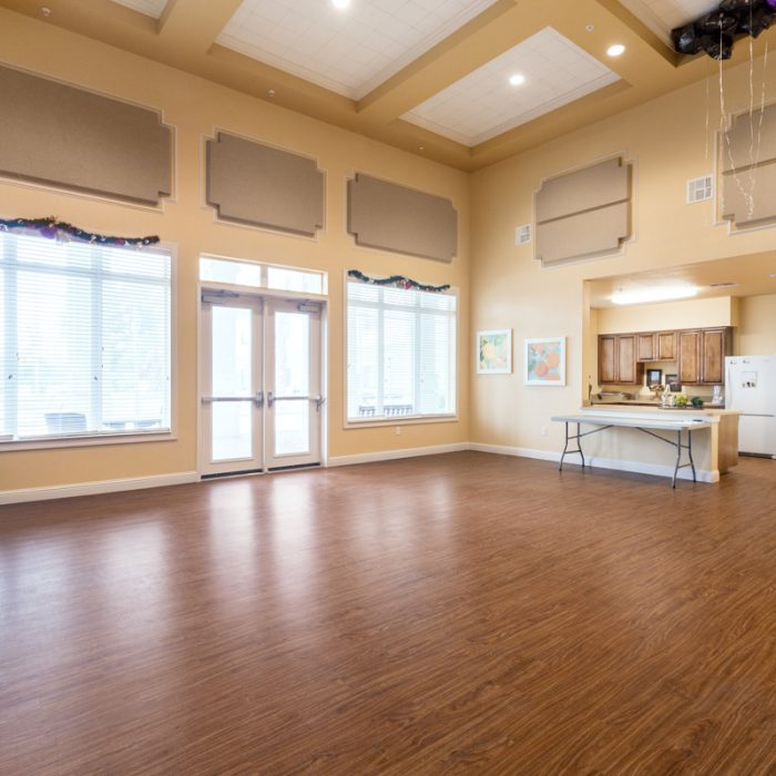 Empty event room for Madison Crossing Market Rate Senior Living Apartments by Summit Contracting Group