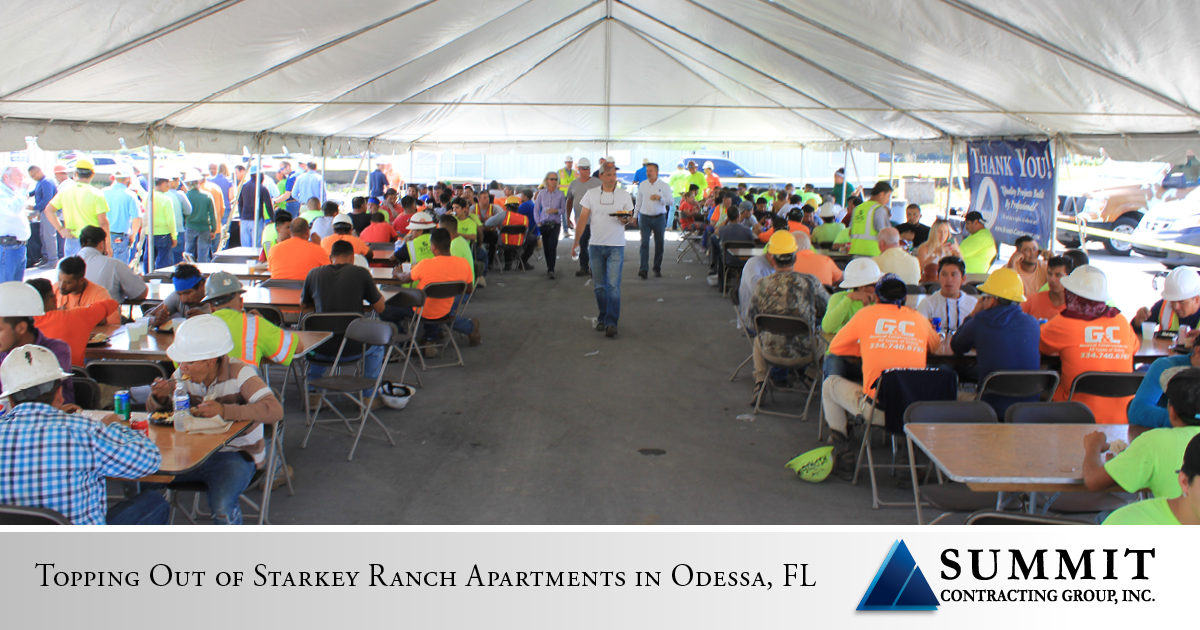 Construction workers eating at Volaris Starkey Ranch Market Rate Apartments Top Out