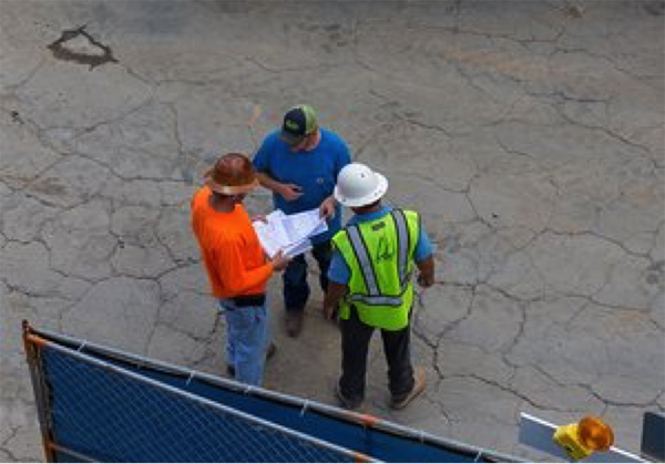 Group of construction workers planning at Summit Construction Group site