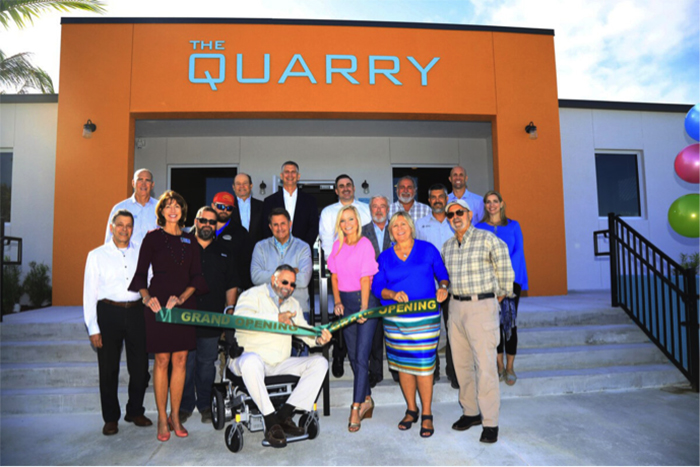 Group photo of opening event at The Quarry Affordable Workforce Housing Development by Summit Contracting Group
