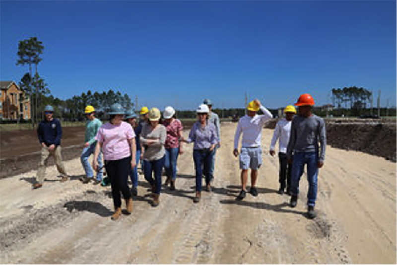 Students participating in the UNF Construction Management Program Tour with Summit Contracting Group