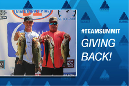 Team Summit Giving Back event with employees posing with fish
