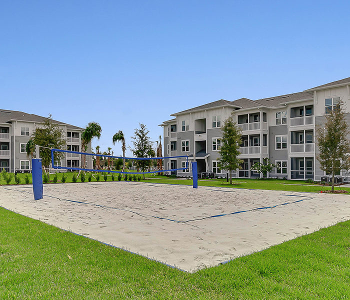 cropped image of beach volleyball and apartments buildings