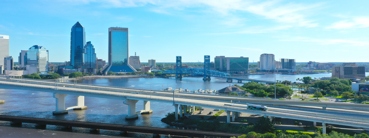 View of bridges and high-rise buildings of Downtown Jacksonville from the Southbank