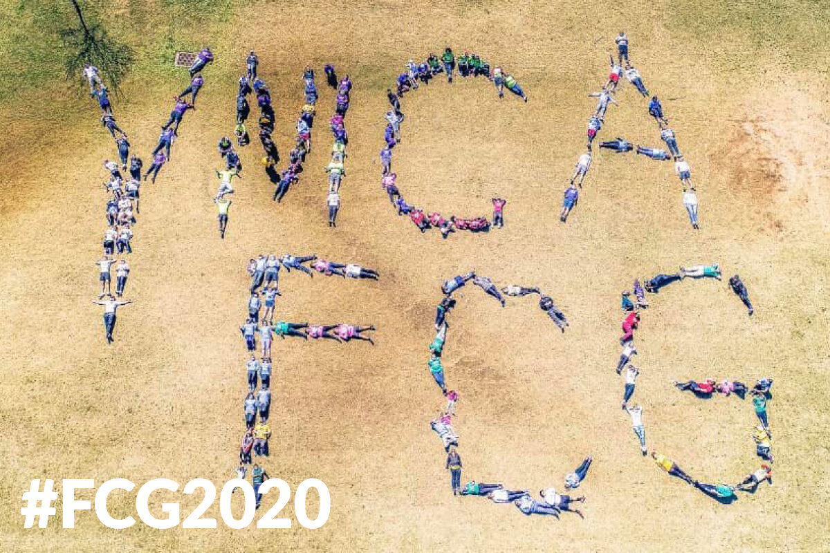 "Aerial view of ""YMCA FCG"" spelled by people doing yoga for #FCG2020"