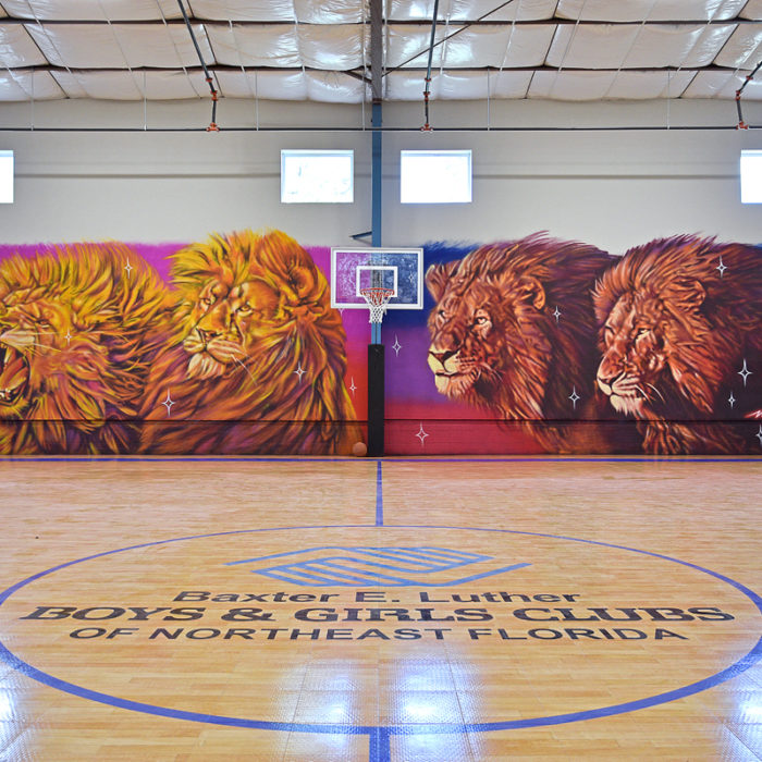 Boys and Girls Club gymnasium with mural
