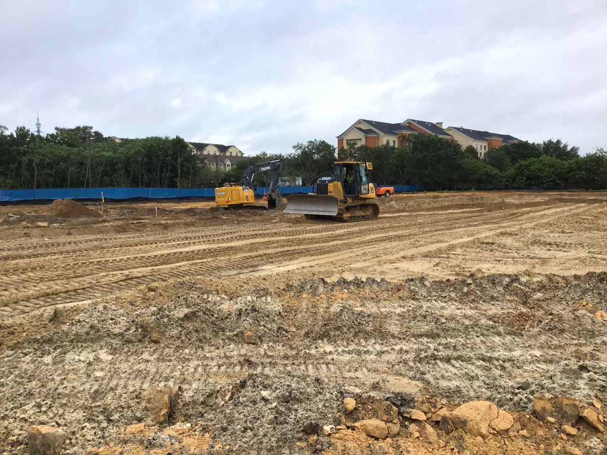 bulldozers moving dirt at Republic Square construction site